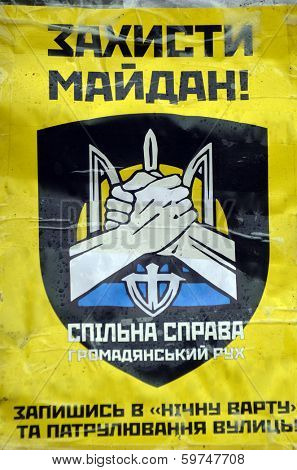 KIEV, UKRAINE - FEB 10, 2014: Downtown of Kiev.Ukrainian SS (Spylna Sprava) propaganda poster. Riot in Kiev and Western Ukraine.February 10, 2014 Kiev, Ukraine