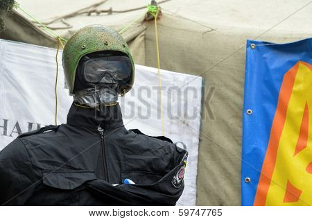 KIEV, UKRAINE - FEB 10, 2014: Downtown of Kiev.Doll wears police uniform and helmet of policeman EXECUTED in the camp of protesters. Riot in Kiev and Western Ukraine.February 10, 2014 Kiev, Ukraine