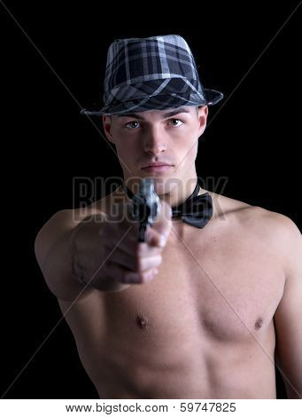 Attractive Shirtless Young Man With Bow-tie And Hat Pointing Gut At Camera