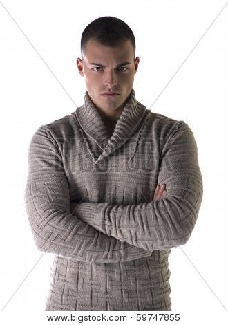 Attractive Young Man With Stern, Severe Expression, Arms Crossed On Chest