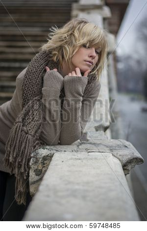 Attractive Blonde Young Woman Leaning On Marble Baluster