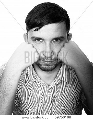 portrait of man thinking deeply in black and white