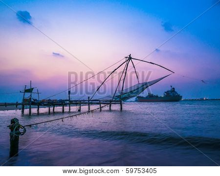 Kochi Chinese Fishnets And Vessel On Sunset  In Kerala. Fort Kochin, Kochi,  South India