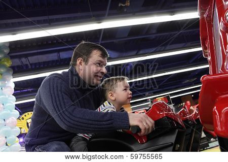 Father With Son At An Amusement Park