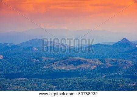mountains in a pre-dawn haze India kerala