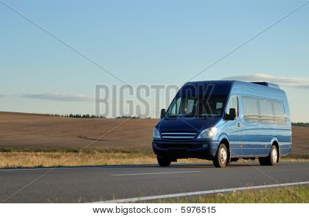 Blue Minibus On Highway