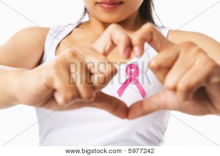Heart Framing On Woman Chest With Pink Badge To Support Breast Cancer Cause
