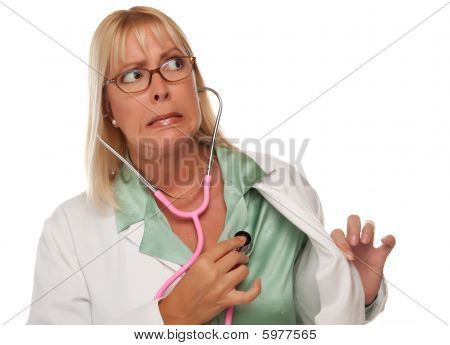 Attractive Female Doctor Or Nurse Checking Her Own Heart