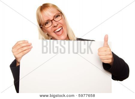 Attractive Blonde With Thumbs Up Holding Blank White Sign