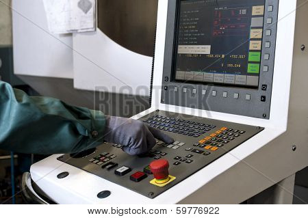 Hand On The Control Panel Of A Computer Numerical Control Programmable Machine