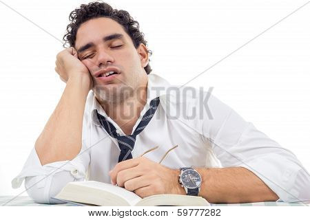 Sleepy Man With Glasses In White Shirt And Tie Sitting With Book