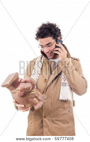 Smiling Professor On The Phone  In Coat With Glasses Looking Artifact