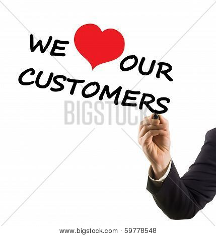 businessman hand writing text we love our customers