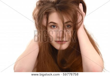 Young girl with messy long brown hair.