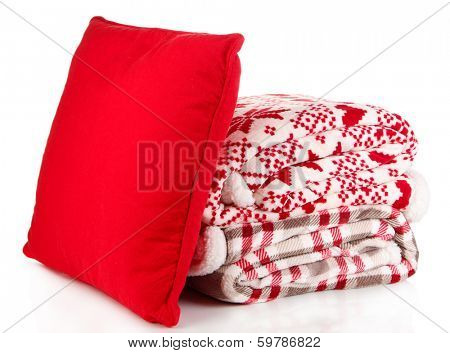 Pile warm plaids and pillow isolated on white