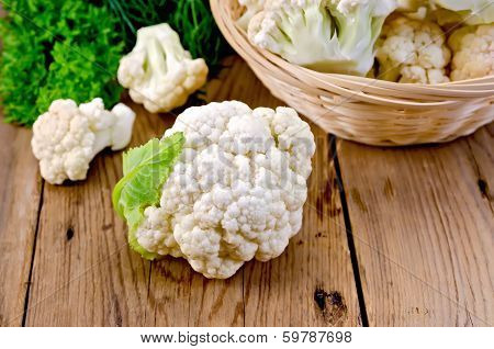 Cauliflower With A Basket On The Board