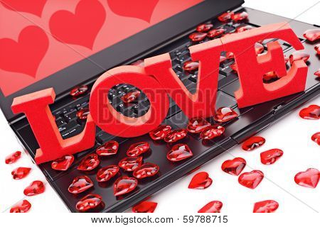 Love or online internet dating concept heart shape symbol on laptop keyboard
