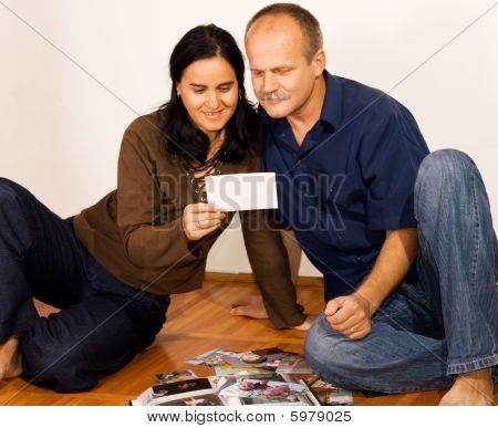 Happy Couple With Photo Album