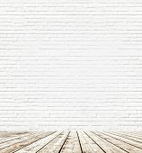 Background of aged grungy textured white brick and stone wall with light wooden floor from whiteboar