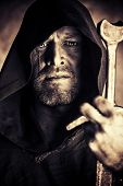 image of cloak  - Portrait of a courageous warrior wanderer in a black cloak and sword in hand - JPG