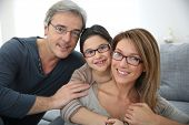 stock photo of daddy  - Portrait of family of 3 people wearing eyeglasses - JPG