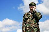 picture of army soldier  - soldier and cellular phone - JPG