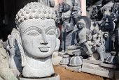 stock photo of inner ear  - Buddha head statue in Mamallapuram Tamil Nadu India - JPG