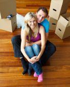 image of married couple  - High angle of a couple sitting on floor together - JPG