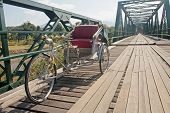 picture of tricycle  - Tricycle on old bridge  - JPG