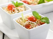 vegetable couscous with cherry tomatoes and mint leaf