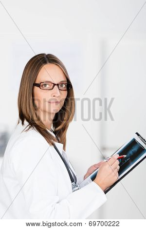 Doctor Or Radiologist Consulting An X-ray