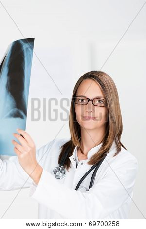Young Woman Doctor Looking At An X-ray