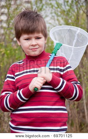 Boy With A Butterfly Net For Catching Butterflies
