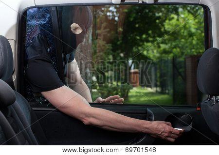 Burglar Opening Car Door