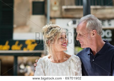 Happy Mature Couple Walking Arm In Arm