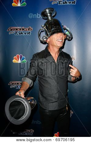 NEW YORK-AUG 6: Comedian Howie Mandel wears the US Open Tennis trophy at the 'America's Got Talent' post show red carpet at Radio City Music Hall on August 6, 2014 in New York City.