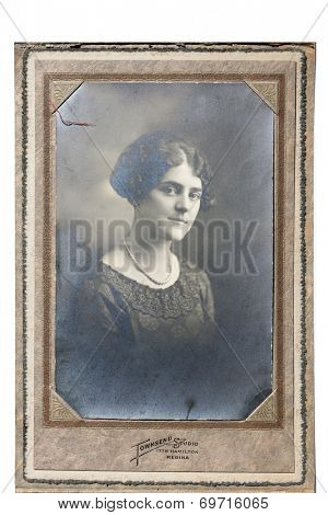 USA- CIRCA 1900s: An antique photo shows studio portrait of a young woman.