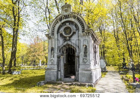 Ancient tomb in the autumn forest