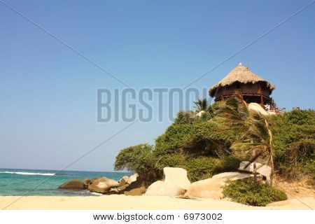 Hut with hammocks on a Caribbean beach. Tayrona National Park. Colombia.