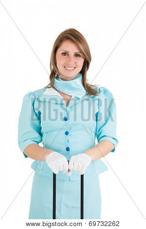 Portrait of a beautiful stewardess dressed in blue uniform over white background