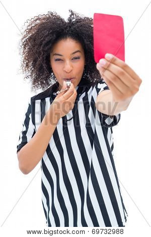 Pretty referee blowing her whistle and showing red card on white background