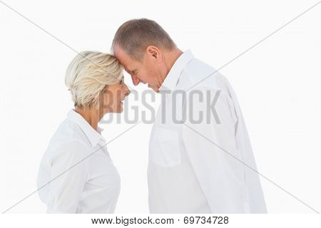 Angry older couple arguing with each other on white background