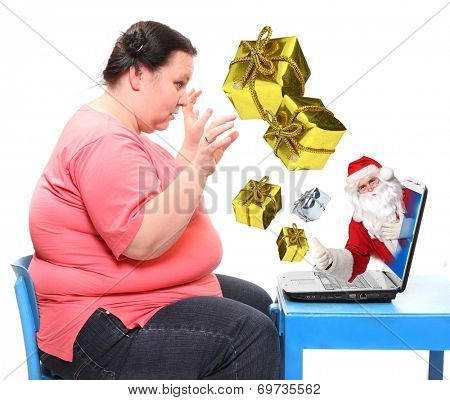 Overweight woman buying christmas gifts in e-shop with Santa Claus. Online shopping concept.