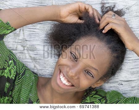 Young Afro beauty breading her hair