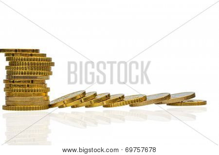 stacked coins and lying, symbol photo for debt, drop in profits and deductions
