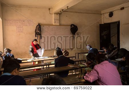 KATHMANDU, NEPAL - DEC 19, 2013 : Unknown children in the lesson at public school. Adult literacy (age 15+) 60.3% (female: 46.3%, male: 73%) in a 2010 population census.