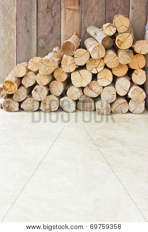 Pile Of  Dry Firewood On The Ground With Copy Space.