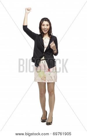 Carefree Celebrating Businesswoman Jumping With Joy