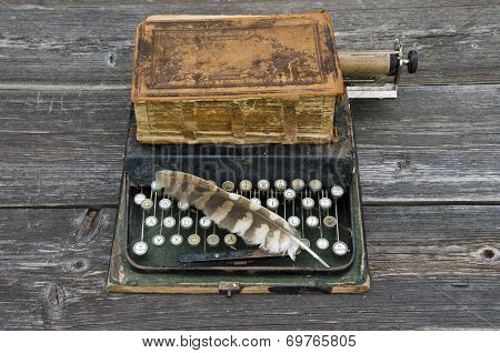 Antique Typewriter With  Old Book Bible And Bird Feather