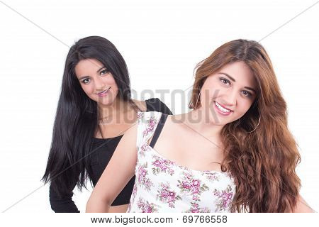 two beautiful young girls posing